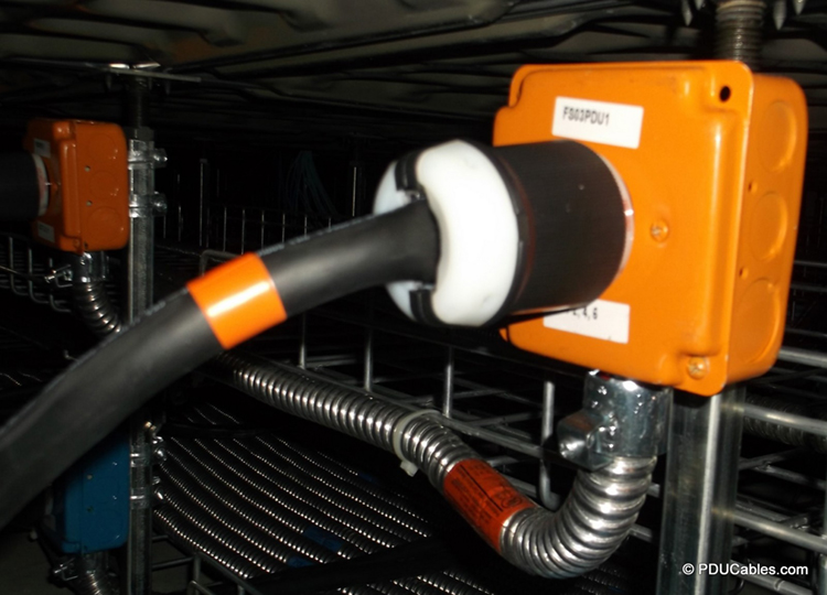 Data center power cable mounted to raised floor strut